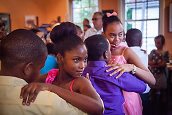 """Tianna Sookram, front, and Paris Chin put on their best Tango faces.  Students of Dancing Classrooms of the Virgin Islands dance at a reception for their parents, family community, and school partners at the Virgin Islands Council on the Arts.  Students spent weeks learning the Tango, Foxtrot, Meringue, Swing, Rumba, and Waltz that will culminate in """"Colors of the Rainbow"""" team match competition at Reichhold Center for the Arts on Saturday, May 9, 2015.  St. Thomas, USVI.  8 May 2015.   © Aisha-Zakiya Boyd"""