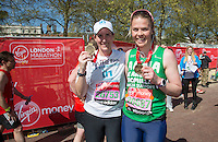 Katherine Grainer and Anna Watkins at the end of the Virgin Money London Marathon 2014 on Sunday 13 April 2014<br /> Photo: Roger Allan/Virgin Money London Marathon<br /> media@london-marathon.co.uk