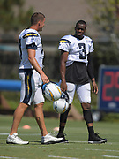 Aug 6, 2018; Costa Mesa, CA, USA: Los Angeles Chargers quarterbacks Philip Rivers (17) and Geno Smith (3) during training camp at the Jack. R. Hammett Sports Complex.