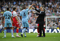 Football - Premier League - Manchester City vs. Queens Park Rangers<br /> Roberto Mancini Manager of Manchester City comes onto the field to remonstrate with QPR players following Joey Bartons sending off at the Etihad Stadium, Manchester