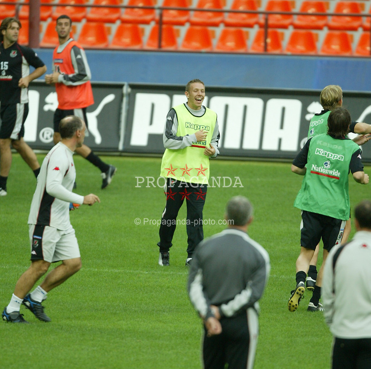 MILAN, ITALY - Thursday, September 4, 2003: Wales' Craig Bellamy watched by manager Mark Hughes during training at the San Siro ahead of their Group 9 Euro 2004 qualifyer against Italy. (Pic by David Rawcliffe/Propaganda)