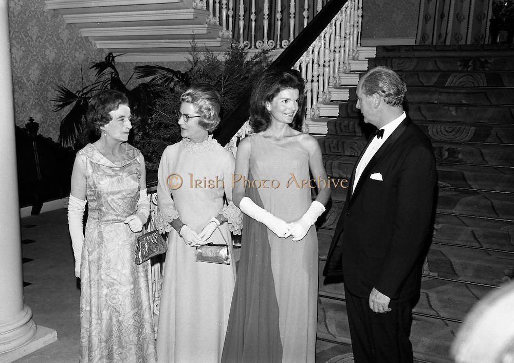 An Taoiseach Mr. Jack Lynch T.D. entertains  Mrs. Jackie Kennedy at a reception at St. Patrick's Hall, Dublin Castle..Jackie Kennedy with her hosts Jack Lynch and his wife in the reception hall of Dublin Castle where she attended her first formal function since her arrival in Ireland. On the left is Mrs. Frank Aiken..30.06.1967