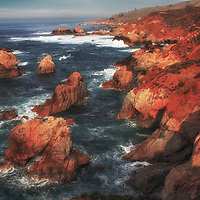 Sunrise along a rugged coastline, sea stacks, and waves, Big Sur Coast, California.