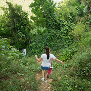 JULY 19, 2018----UTUADO, PUERTO RICO---<br /> The power line that has been disconnected since the path of Hurricane Maria on September 20, 2018 and has kept this family, go down  a dirt path to collect groceries.<br /> (Photo by Angel Valentin/Freelance)