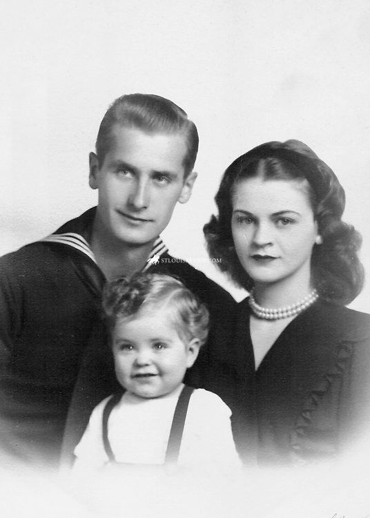 Historical image of Archbishop Robert J. Carlson at 14 months with parents