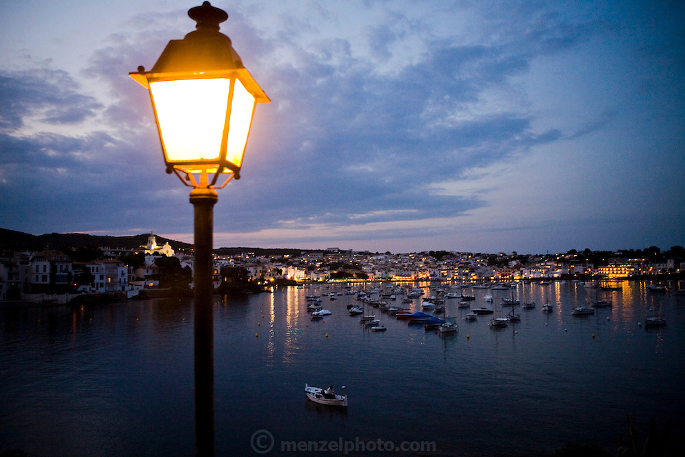 Boats docking at a port at sunset in Cadaques, Spain.
