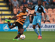 Barnet player Andy Yiadom shoots under pressure from Wycombe Wanderers player Michael Harriman during the Sky Bet League 2 match between Barnet and Wycombe Wanderers at The Hive Stadium, London, England on 15 August 2015. Photo by Bennett Dean.