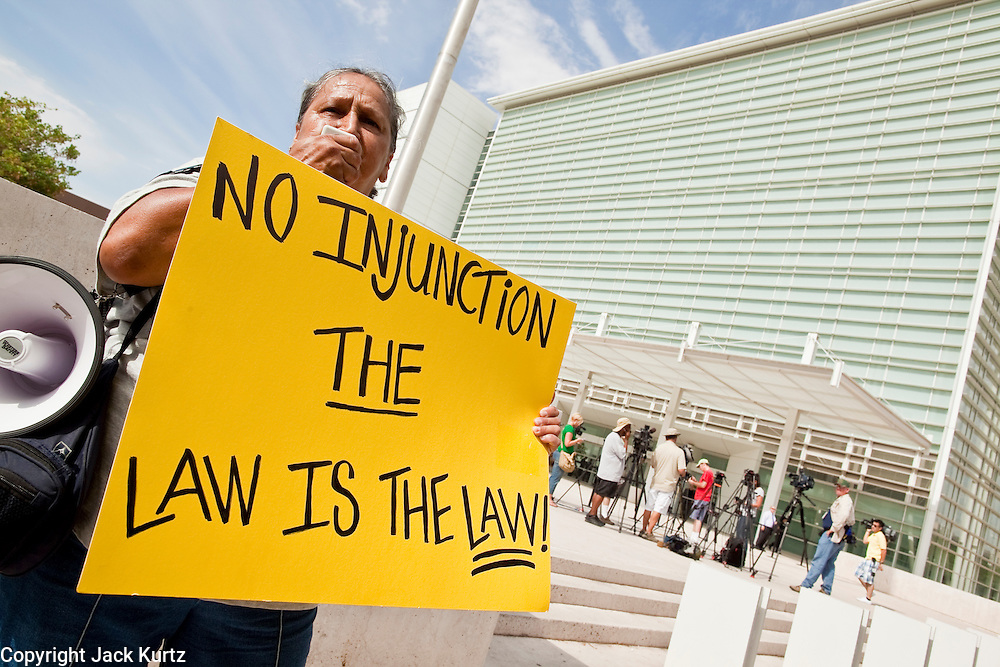 165479 1070suit - 15 JULY 2010 - PHOENIX, AZ: Martha Payan (CQ) from Phoenix, and a supporter of SB 1070 tries to shout down opponents of 1070 Thursday morning. People for and against SB 1070 picketed the front of the Sandra Day O'Connor US Courthouse (CQ) in Phoenix Thursday morning during the first hearing against SB 1070.    ARIZONA REPUBLIC PHOTO BY JACK KURTZ