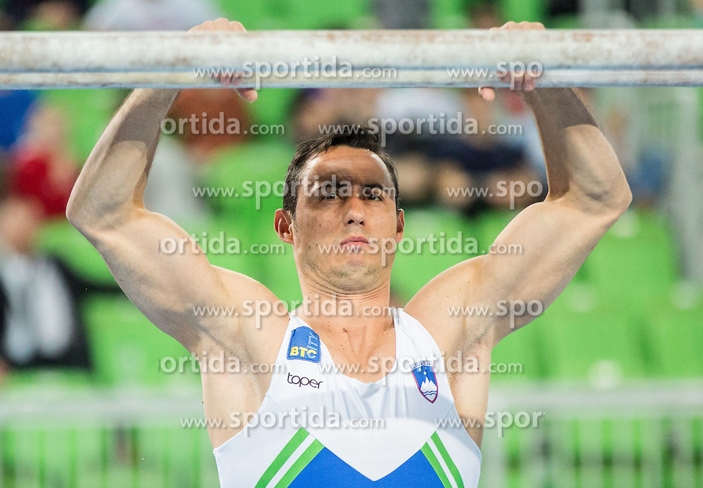 Alen Dimic of Slovenia competes in Parallel Bars during Qualifications of Artistic Gymnastics World Cup Ljubljana, on April 8, 2016 in Arena Stozice, Ljubljana, Slovenia. Photo by Vid Ponikvar / Sportida
