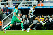 Kiko Femenia (#21) of Watford watches as Kenedy (#15) of Newcastle United controls the ball during the Premier League match between Newcastle United and Watford at St. James's Park, Newcastle, England on 3 November 2018.