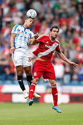 Lee Peltier of Huddersfield and Kike of Middlesbrough compete in the air - Photo mandatory by-line: Rogan Thomson/JMP - 07966 386802 - 13/09/2014 - SPORT - FOOTBALL - Huddersfield, England - The John Smith's Stadium - Huddersfield town v Middlesbrough - Sky Bet Championship.