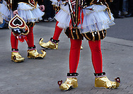 PHILADELPHIA - JANUARY 6:  Members of the Trilby String Band wait to perform during the 2007 Mummers Parade January 6, 2007 in Philadelphia, Pennsylvania. Thousands came to watch the Mummers Parade, which was postponed from New Years Day due to rain. Temperatures in the Philadelphia region were record highs in the low 70's. (Photo by William Thomas Cain/Getty Images)