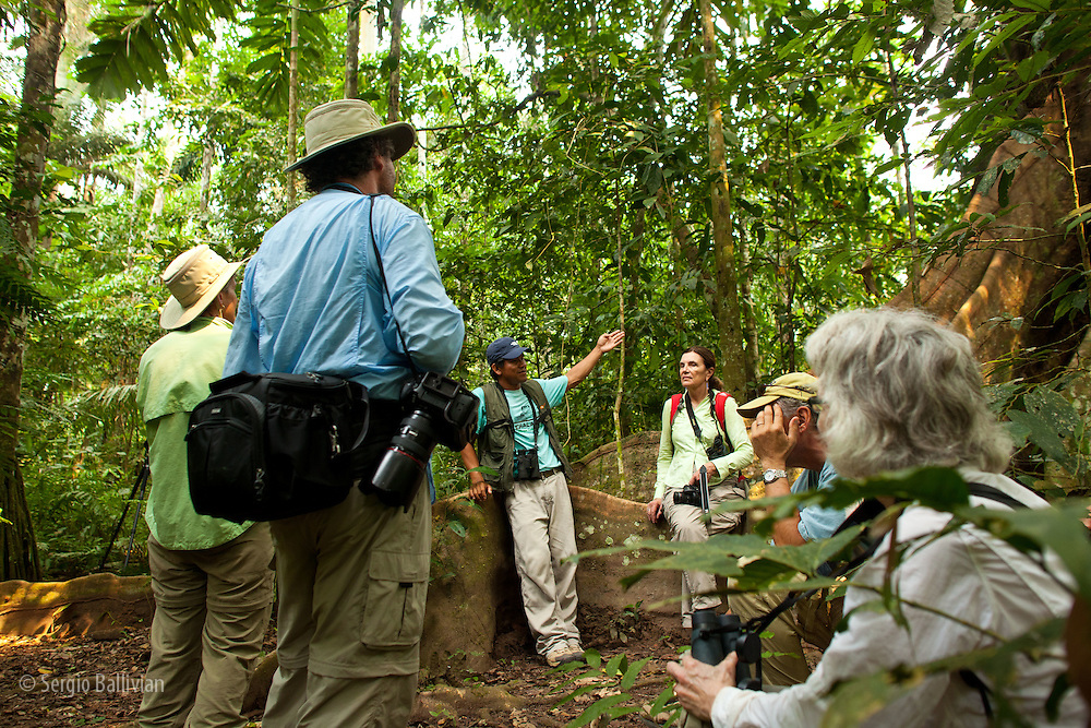 Tourists and guides observe birds, wildlife and plants at Chalalan Lodge in Madidi NP in Bolivia.