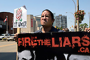 "Windsor, Canada, 2012. Richard Dalkieth, an Occupy Windsor member, poses as an ""angry Indian"" in front of the hotel where Prime Minister Harper will  sign the International Bridge Crossing agreement. The ""Fire the Liar's"" protest is a union initiative."