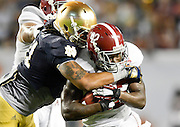 January 7, 2013: Alabama running back Eddie Lacy (42) is tackled by Notre Dame linebacker Ishaq Williams (11)  during 1st half of the Discover BCS National Championship game between the Alabama Crimson Tide and the Notre Dame Fighting Irish at Sun Life Stadium in Miami Gardens, Fl