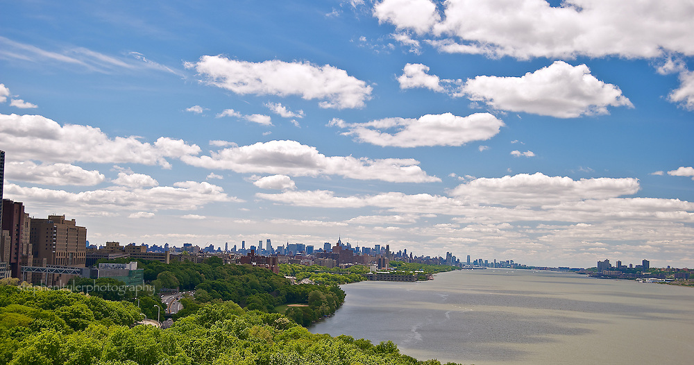 Looking south from upper Manhattan along Riverside Park and the West Side highway and Hudson River with skyline of mid-Manhattan in background.