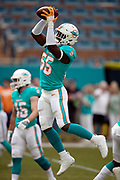 Miami Dolphins rookie outside linebacker Jerome Baker (55) leaps and catches a pass during pregame warmups before the NFL week 9 regular season football game against the New York Jets on Sunday, Nov. 4, 2018 in Miami Gardens, Fla. The Dolphins won the game 13-6. (©Paul Anthony Spinelli)