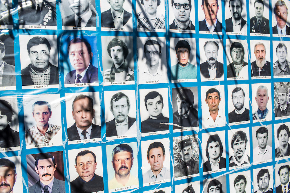 DONETSK, UKRAINE - APRIL 25: Photographs of victims of the 1986 Chernobyl nuclear accident are displayed at the site of a memorial service to commemorate the annivesary on April 25, 2014 in Donetsk, Ukraine. The accident, which took place in the northern part of Ukraine, is considered the worst nuclear accident in history. (Photo by Brendan Hoffman/Getty Images) *** Local Caption ***