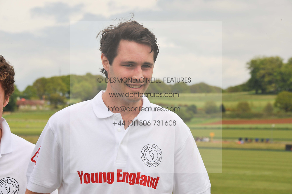 LANDO SHERIDAN at the St.Regis International Polo Cup between England and South America held at Cowdray Park, West Sussex on 18th May 2013.  South America won by 11 goals to 9 goals.