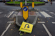 Confusing and contradiction of a diversion sign near a roundabout in East Dulwich, south London.