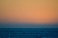 The Green Flash seen at sunset over the Pacific Ocean, San Mateo County coast, California