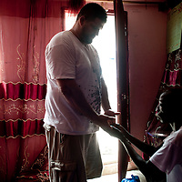 02/07/2012. Senegal, Dakar. One day with the White Lion.    The canarian wrestler Juan Espino, the unique white fighter in the senegalese wrestling.  Juan follows the instructions of the Marabout to have the maximum chance to win his next fight . ©Sylvain Cherkaoui