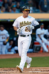 OAKLAND, CA - SEPTEMBER 21:  Mark Canha #20 of the Oakland Athletics scores a run against the Texas Rangers during the first inning at the RingCentral Coliseum on September 21, 2019 in Oakland, California. The Oakland Athletics defeated the Texas Rangers 12-3. (Photo by Jason O. Watson/Getty Images) *** Local Caption *** Mark Canha