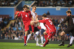BIRMINGHAM, ENGLAND - Monday, October 13, 2008: Wales' Sam Vokes and England's David Wheater during the UEFA European Under-21 Championship Play-Off 2nd Leg match at Villa Park. (Photo by Gareth Davies/Propaganda)