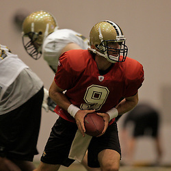10 August 2009: New Orleans Saints quarterback Drew Brees (9) looks to hand off during New Orleans Saints training camp at the team's indoor practice facility in Metairie, Louisiana.