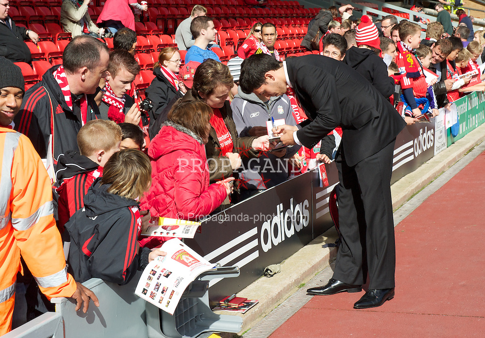 LIVERPOOL, ENGLAND - Saturday, September 25, 2010: Liverpool's Daniel Pacheco signs autographs for supporters before the Premiership match against Sunderland at Anfield. (Photo by David Rawcliffe/Propaganda)