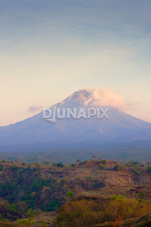 Mt. Ebulobo smoulders over the So'a Basin. Active volcanoes have pumped sediment into the basin for more than a million years, offering a long archaeological and paleontological record for the region.