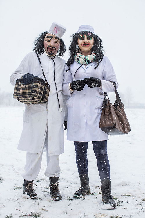 Kostiantyn Pleshka, 35, left, and Kostiantyn Iliuts, 28, dressed in nurse costumes, pose for a portrait during celebrations of the Malanka Festival on Thursday, January 14, 2016 in Krasnoilsk, Ukraine. The annual celebrations, which consist of costumed villagers going in a group from house to house singing, playing music, and performing skits, began the previous sundown, went all night, and will last until evening. According to tradition, married men are only able to take part in Malanka wearing a mask.