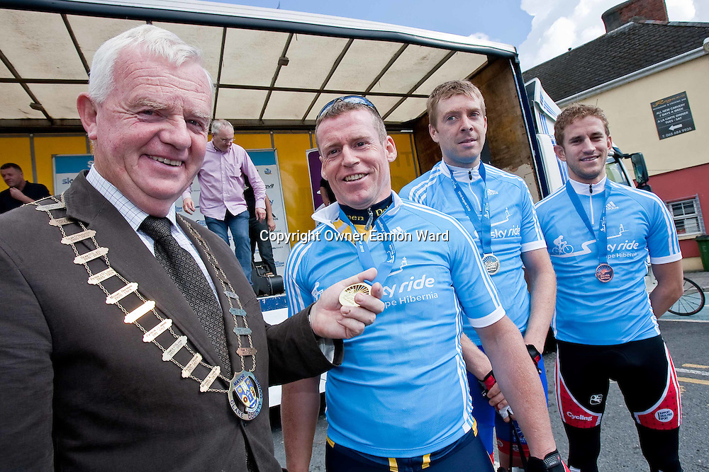 Mayor of Clare Christy Curtin with Philip Colleran ,winner , Eoghan Considine 2nd and Simon Richardson 3rd  after the Etap Hibernia Sky Ride in Ennis on Sunday. Photograph by Eamon Ward