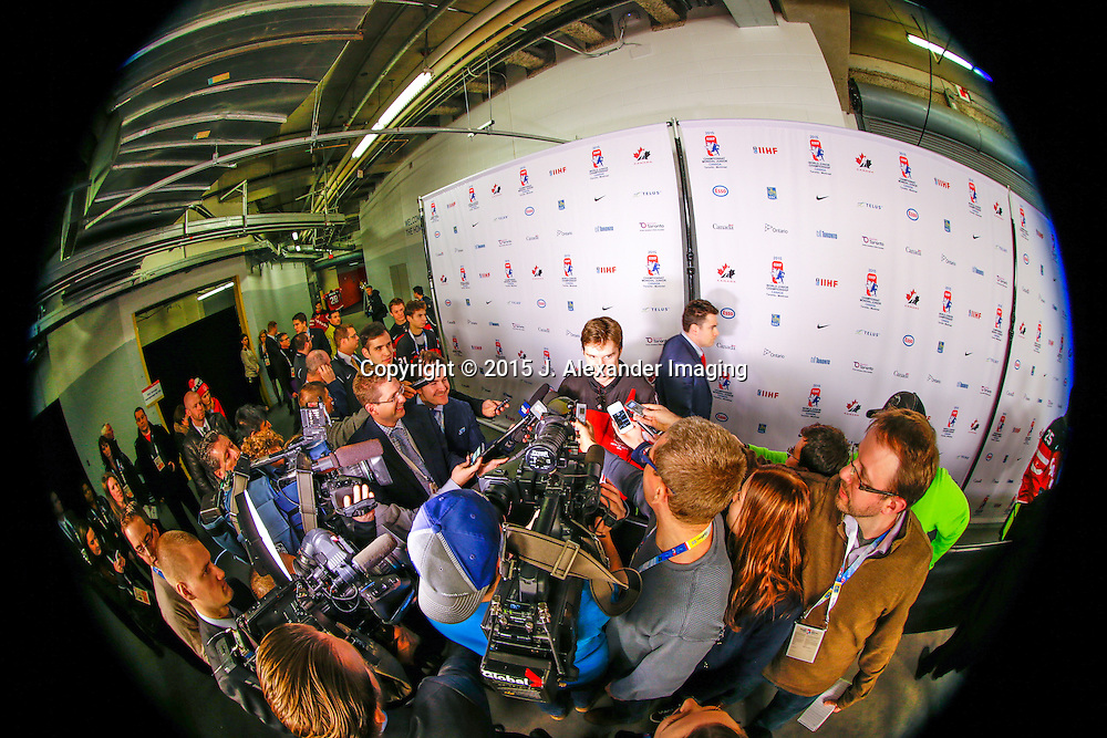 Top NHL draft prospect, Connor McDavid, is interviewed at a press conference during the 2015 IIHF Junior World Championships.