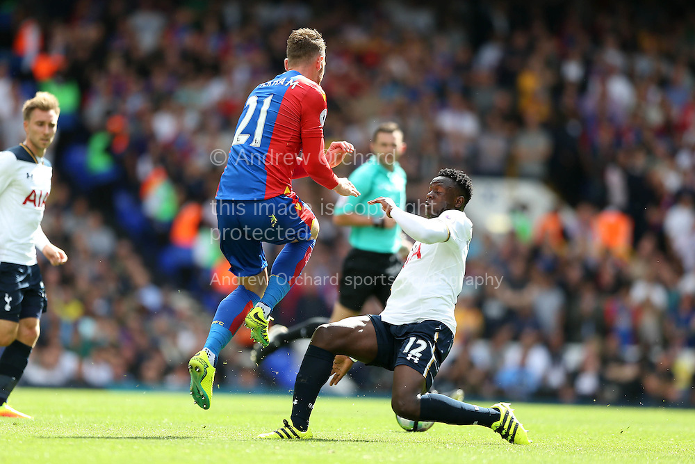 Victor Wanyama of Tottenham Hotspur tackles Connor Wickham of Crystal Palace. Premier league match, Tottenham Hotspur v Crystal Palace at White Hart Lane in London on Saturday 20th August 2016.<br /> pic by John Patrick Fletcher, Andrew Orchard sports photography.