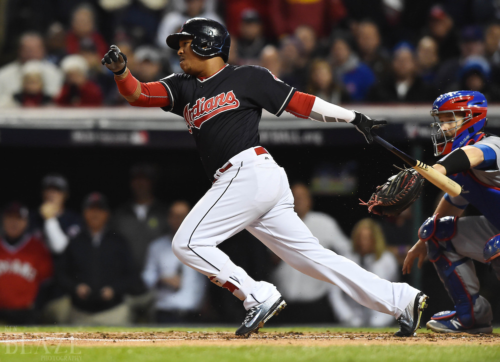 Oct 25, 2016; Cleveland, OH, USA; Cleveland Indians third baseman Jose Ramirez drives in a run with a RBI single against the Chicago Cubs in the first inning in game one of the 2016 World Series at Progressive Field. Mandatory Credit: Ken Blaze-USA TODAY Sports