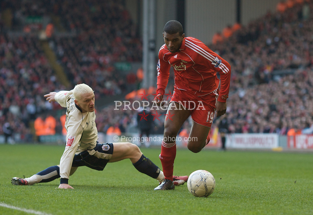 LIVERPOOL, ENGLAND - Saturday, February 16, 2008: Liverpool's Ryan Babel and Barnsley's Bobby Hassell during the FA Cup 5th Round match at Anfield. (Photo by David Rawcliffe/Propaganda)