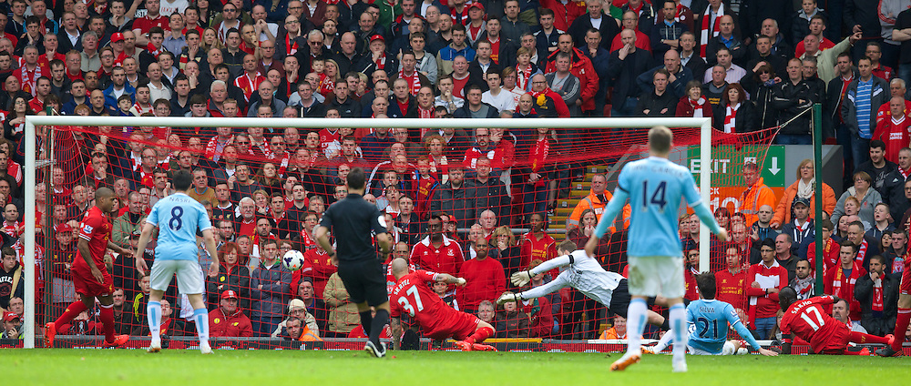LIVERPOOL, ENGLAND - Sunday, April 13, 2014: Manchester City's David Silva scores the first goal against Liverpool during the Premiership match at Anfield. (Pic by David Rawcliffe/Propaganda)