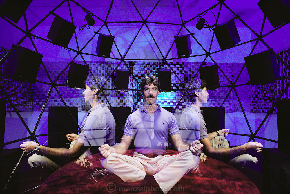 New Age meditation technology. At the John-David Learning Center, inside the Brain/Mind Intensive Dome. The client sits inside the geodesic dome, and is slowly rotated. A 'self- improvement' tape is played through the speakers in the dome, along with other sounds that are said to 'tune-up' the brain. Claimed benefits of long-term use of the equipment include improvements to memory and decision-making abilities and an increase in creativity. The equipment is also claimed to be effective in treating alcohol or drug dependency. The John- David Learning Center is in Carlsbad, California. MODEL RELEASED [1988] Triple exposure.