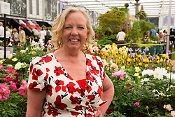 © Licensed to London News Pictures. 19/05/2014. London, England. Dragon's Den star Deborah Meaden in the Grand Pavilion.  Press Day at the RHS Chelsea Flower Show. On Tuesday, 20 May 2014 the flower show will open its doors to the public.  Photo credit: Bettina Strenske/LNP