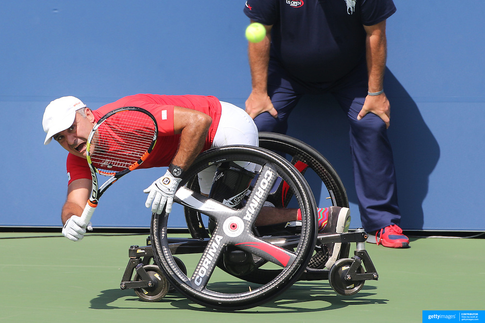 Stephane Houdet, France in action, losing in three sets to  Shingo Kunieda, Japan, in the Wheelchair Men's Singles Final during the US Open Tennis Tournament, Flushing, New York, USA. 13th September 2015. Photo Tim Clayton