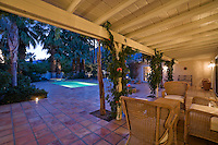 Patio with chairs and table at dusk