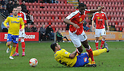 Uche Ikpeazu avaiding the challenge from Dean Leacock during the Sky Bet League 1 match between Crewe Alexandra and Crawley Town at Alexandra Stadium, Crewe, England on 3 April 2015. Photo by Michael Hulf.