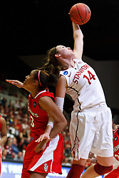 March 21, 2011; Stanford, CA, USA; Stanford Cardinal forward Kayla Pedersen (14) grabs a rebound from St. John's Red Storm forward Da'Shena Stevens (3) during the second half of the second round of the 2011 NCAA women's basketball tournament at Maples Pavilion. Stanford defeated St. John's 75-49.