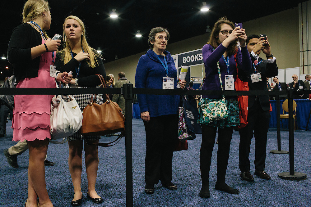 Attendees watch from outside the ropes as Ann Coulter signs books during the final day of the Conservative Political Action Conference (CPAC) at the Gaylord National Resort & Convention Center in National Harbor, Md.