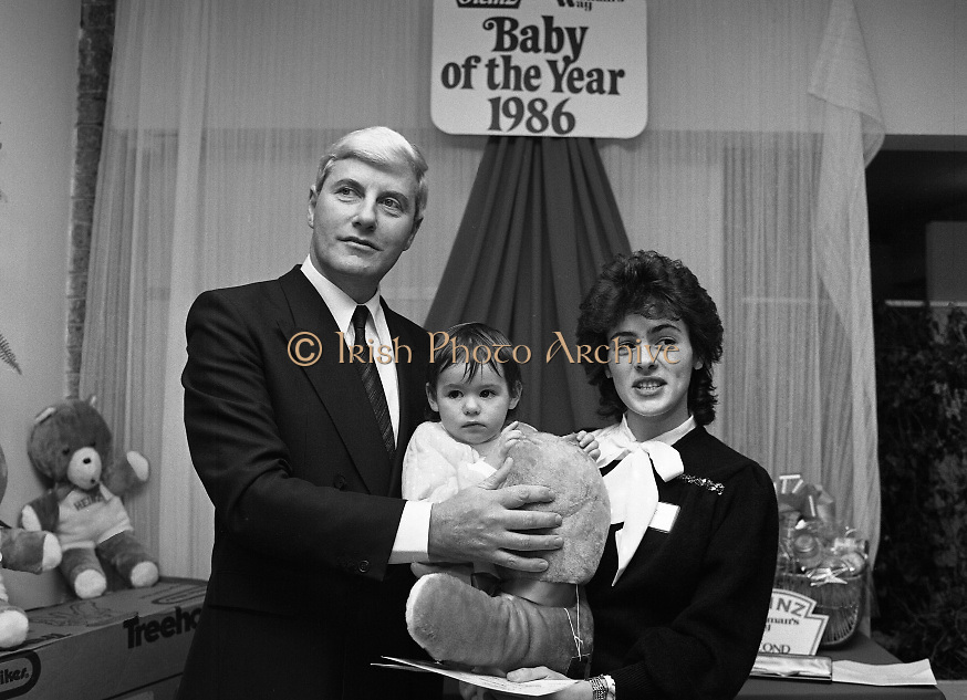 Heinz / Woman's Way, Baby of the Year..1986..21.11.1986..11.21.1986..21st November 1986..The 19th Annual 'Baby of the Year' awards ceremony took place at the Zoological Gardens,Dublin..Baby, Alan Smith from Co Meath was the overall winner.Amy Dempsey from Dublin and Brendan Gallagher from Waterford were placed 2nd and 3rd...Photograph of Amy Dempsey cuddling her new teddy.Amy was placed second overall. she is accompanied by her mother Pauline and Mr John Paul O'Reilly.The Dempsey family reside in Glasnevin,Dublin.