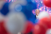 GOP Vice Presidential candidate Gov. Mike Pence watches as balloons and confetti drop after accepting the party nomination for president on the final day of the Republican National Convention July 21, 2016 in Cleveland, Ohio.