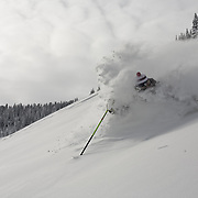 Chris Carpenter skis down towards the highway in the Vail backcountry of Colorado.