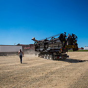 Extensive harvesting equipment is loaded up to transport from Crowell, Texas to the next wheat harvest in Oklahoma. May 2017.