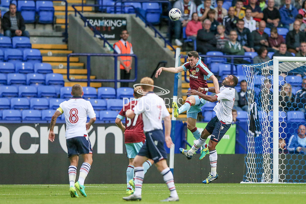 Michael Keane (Burnley) heads the ball clear during the Pre-Season Friendly match between Bolton Wanderers and Burnley at the Macron Stadium, Bolton, England on 26 July 2016. Photo by Mark P Doherty.